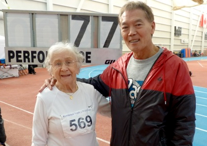 Olga and Harold pose with her WR indoor high jump for W90.