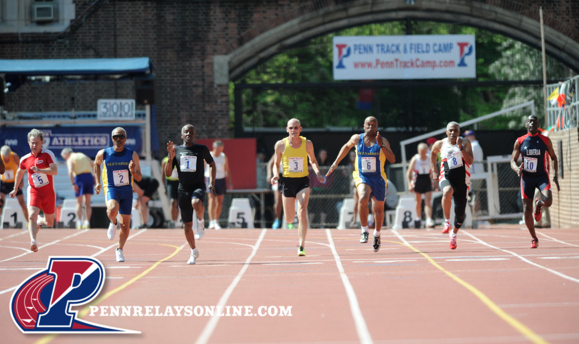 Charles Allie (No. 1) is shown on way to victory in M65 100 at Penn Relays.