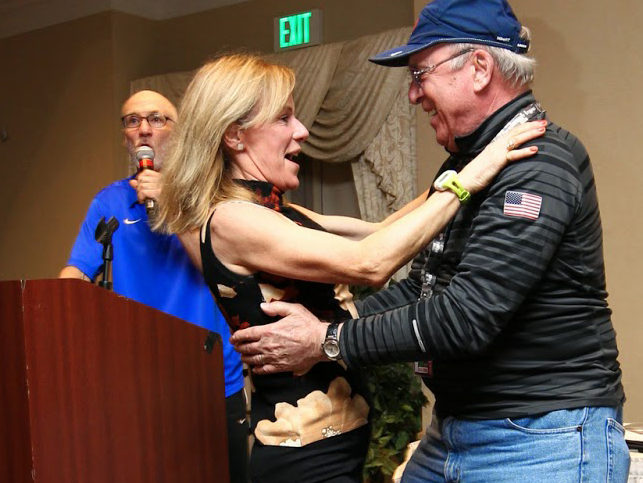 Don Lein congratulates Christine Kennedy on an AR at 2015 USATF 8K Masters Championships in Brea, California.