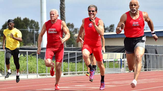 Greg Pizza, in the shades, sprints with red-wearing Striders teammates at a recent meet. Photo by Ken Stone