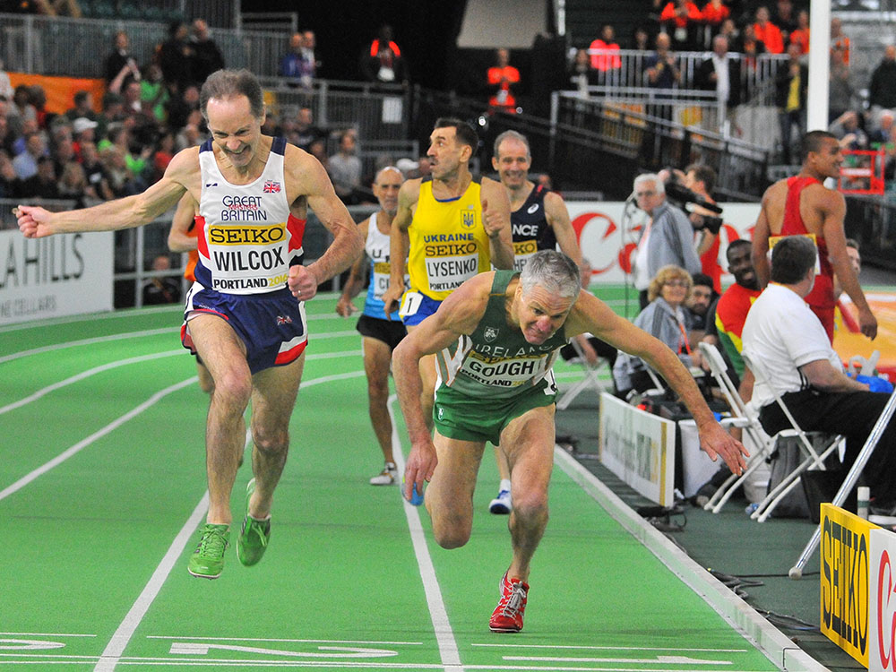 Joe Gough begins a lunge at finish of masters men's 800 at Portland IAAF worlds.