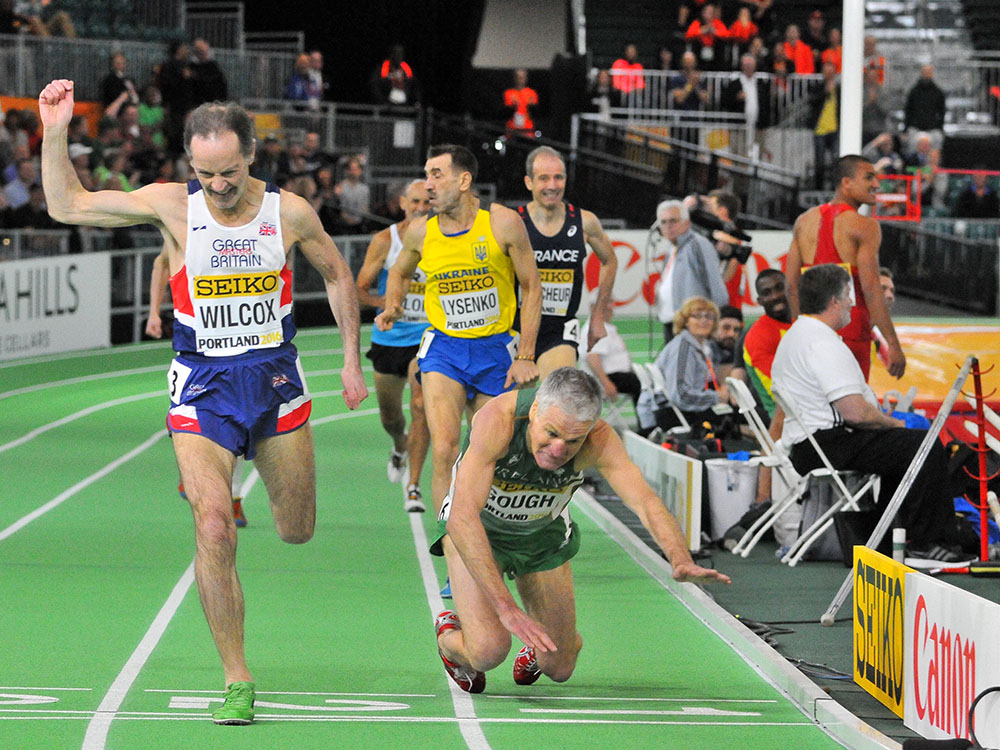 Dave Wilcock finishes inches ahead of a falling Joe Gough in masters men's 800.