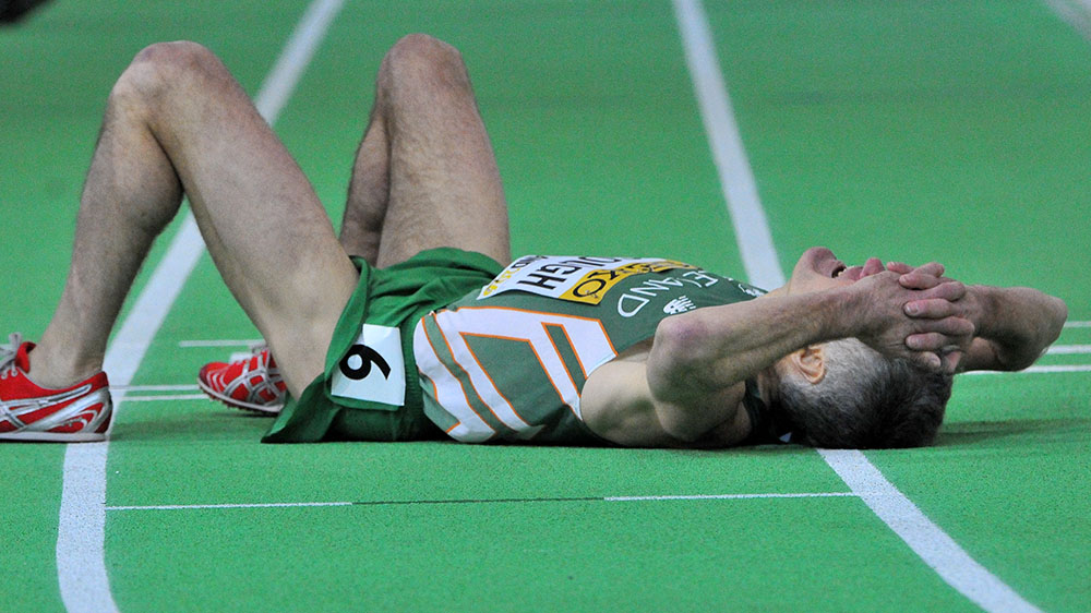 Joe Gough lay on the track, exhausted, after giving his all in the masters men's 800.