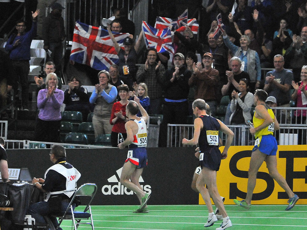 British flags greet 800 winner David Wilcock on the backstretch of his victory lap.