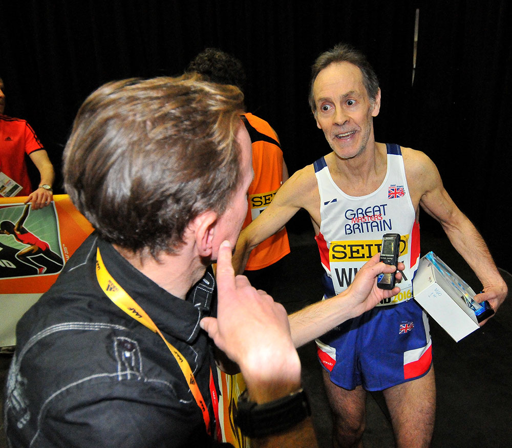 David Wilcock describes his race to an interviewer in the mixed zone.