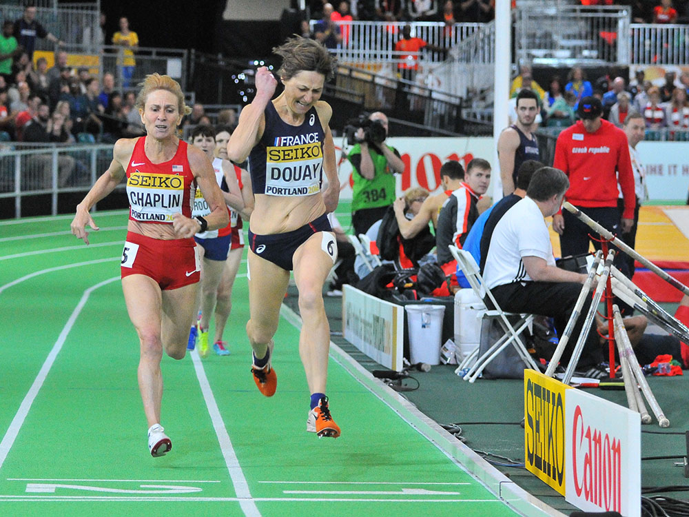 Helene Marie Douay takes final stride of women's 800 ahead of Lesley Chaplin.