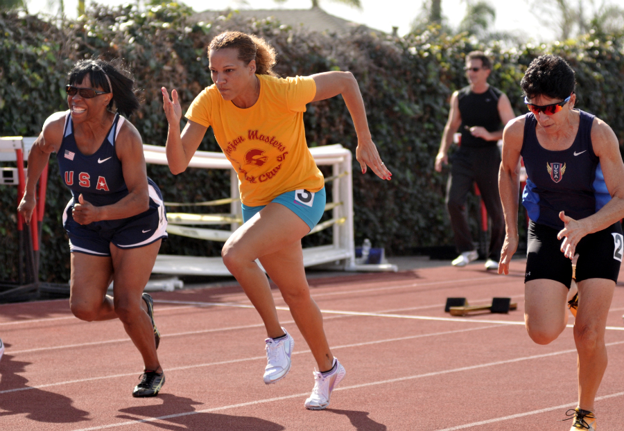 April Jace (in yellow) beat Brenda Matthews (left) and Linda Cohn at a February 2014 meet at Mater Dei High School in Santa.