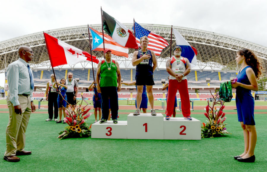 Ed Hearn hears national anthem at Costa Rica stadium at WMA regionals.