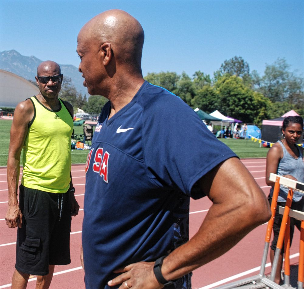 Mike Powell (left) gives Willie support during triple jump.