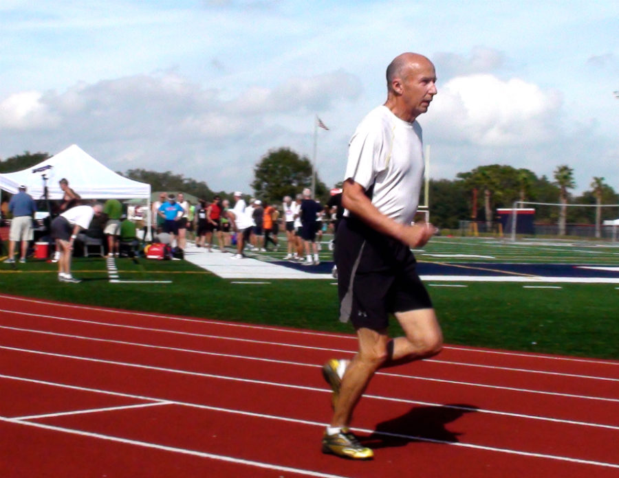 Roger, shown running the 800 at  a recent Florida Senior Games, had a 2013 best of 3:28.51, which met A-A standard for M75