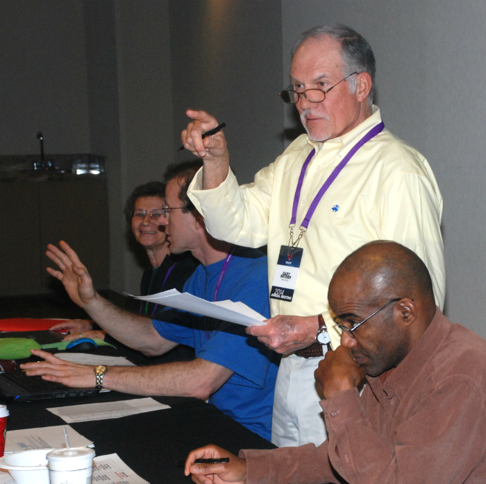 Gary Snyder presides at MT&F Executive Committee meeting, behind Vice Chair Robert Thomas.