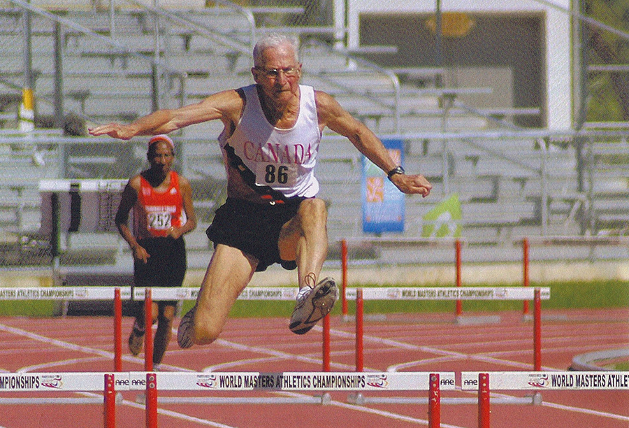 Earl flies in a 200-meter hurdles race that set M80 world record of 36.95.