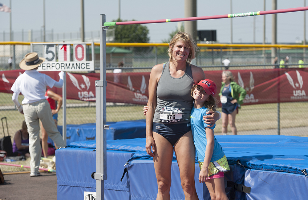 Gwen squeezes her daughter Paris, herself a 9-10 high jump champion.