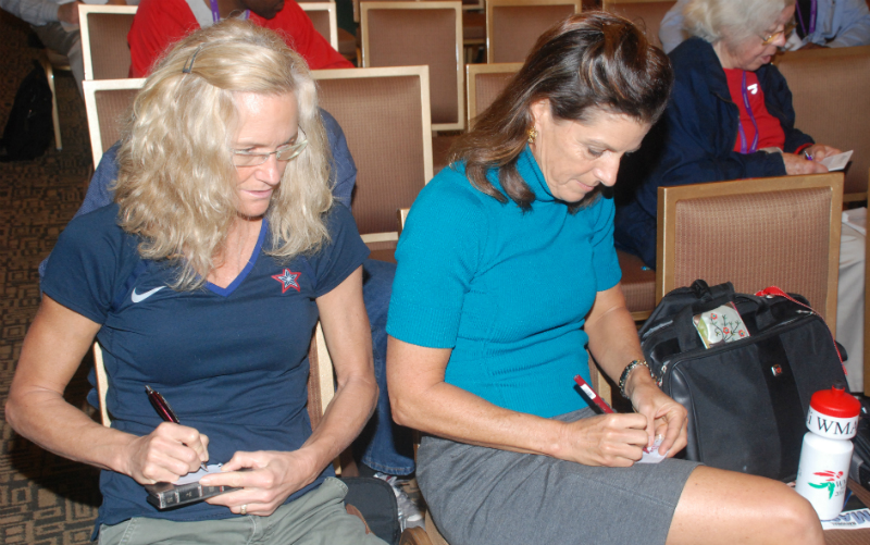 Martha Mendenhall (left) and Joy Upshaw make out their ballots for 2017 indoor nationals.