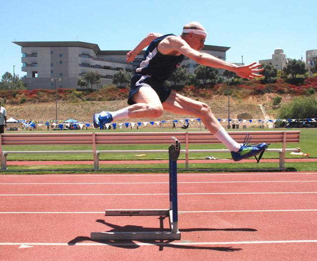Ken hurdles and hustles.