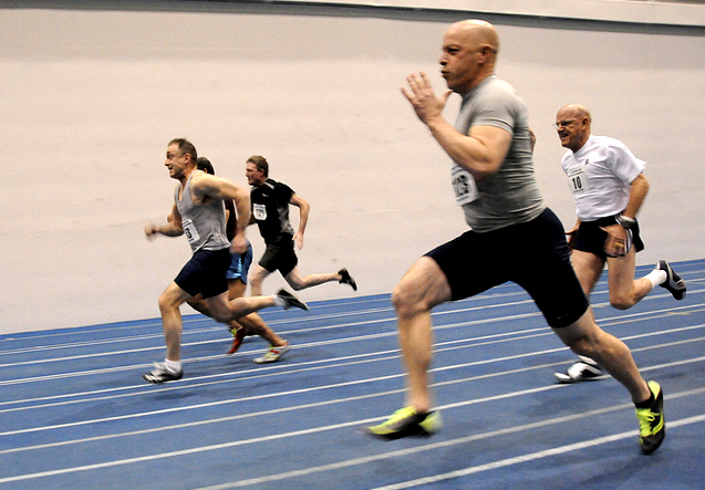 Sprinters zip past Dave Albo's camera at Mid-America Indoor championships.