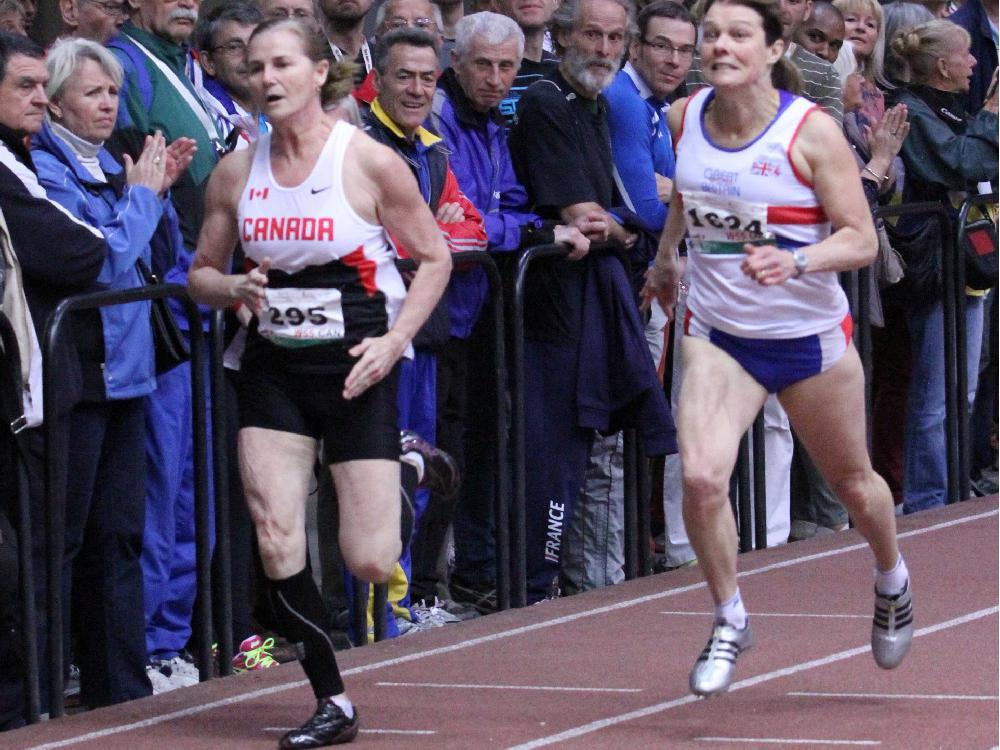 Ottawa Lions Track and Field Club's Wendy Alexis, left, heads for the finish line and a victory in the women's 55-59 age group 200-metre final at the world masters indoor athletics championships in Budapest. Photo by Doug Smith