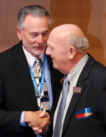 Rex (left) congratulates Stan on one-vote victory in Lahti.