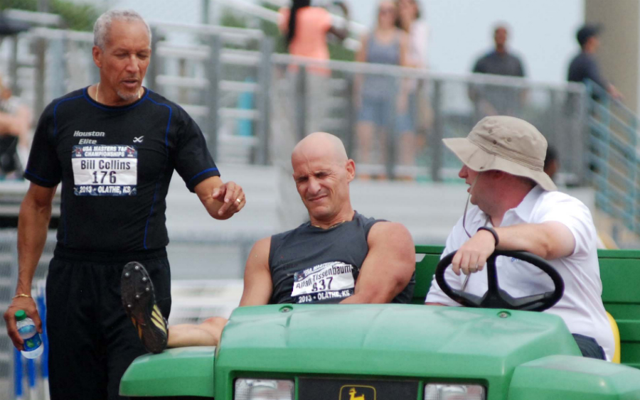 Bill Collins offers psychic support as Allan is carted off the Olathe track.