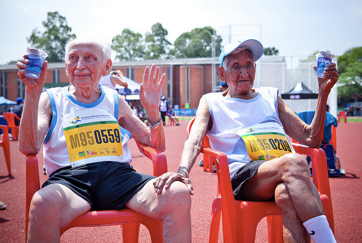 The essence of masters track — relaxing with a friend after hard-fought race.