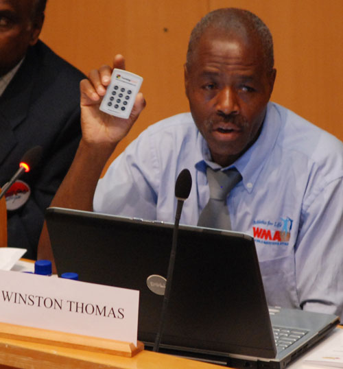 WMA Secretary Winston Thomas shows voting device at Lahti elections.